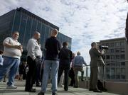 Workers waited in Rosslyn's Freedom Park for a glimpse of the Space Shuttle Discovery.