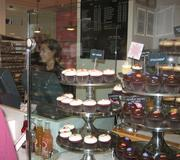 Mmmm. Even the impending hurricane doesn't stop the bakers and icers at Georgetown Cupcake. I buy a dozen.