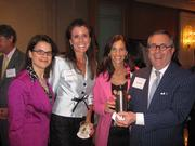 """From left, Melina Duggal of RCLCO, Stacey Shepard and Hollie Dupes, both of Jacobs, with """"wine dude"""" Tom McDuffie, also of Jacobs, at Women & Wine VIII."""