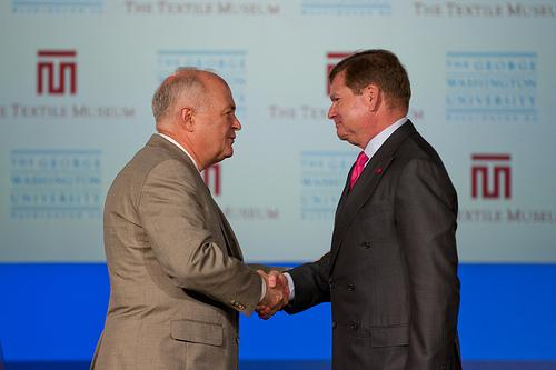 GWU President Stephen Knapp and Textile Museum Board President Bruce Baganz shake hands Tuesday after they announced plans for the museum to move to space on GW's Foggy Bottom campus.