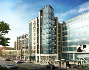 Four Points LLC is seeking buyers for Progression Place, which is slated for completion in October.