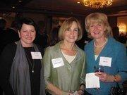 Cynthia Highland of Northrop Grumman, center, with Liz Reno, left, and Patti Cary, both of KPMG at Women & Wine VIII.