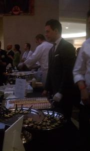 Sommelier Brent Kroll of Adour serves macaroons at the Capital Food Fight.