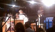 Chefs compete as Padma Lakshmi and Jose Andres, right, look on during the 2012 Capital Food Fight.