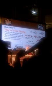 Auction item #1 comes up for bid at the Capitol Food Fight.