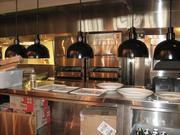 A closeup of the open kitchen at Del Frisco's Grille.