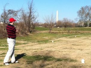 The author's friend watches a shot at East Potomac Golf Course on Jan. 20, taking advantage of an unseasonably warm winter day. We're not alone in golfing more often as temperatures increase, according to PGA PerformanceTrak.