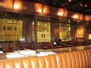 The Hamilton's woodwork detail is reminiscent of the other Clyde's restaurants.