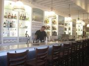 Workers attend to the new bar at Hank's Oyster Bar on Capitol Hill.