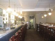 A look at the main dining area of the restaurant, as well as the bar, at Hank's.