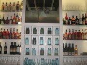 Mason jars containing mixologist Gina Chersevani's creations at Hank's Oyster Bar.
