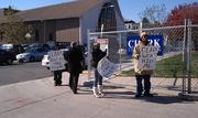 About five protesters held signs accusing the contractor, Clark Construction, of not hiring enough D.C. residents.