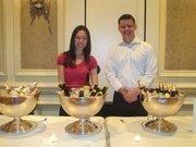 Volunteer Christina Hong and Great American Restaurants employee Andrew Razz serve beer.