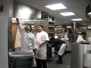 The kitchen (with the two chefs already hard at work before opening) at Rasika West End.