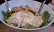 A Smashburger salad with chicken.