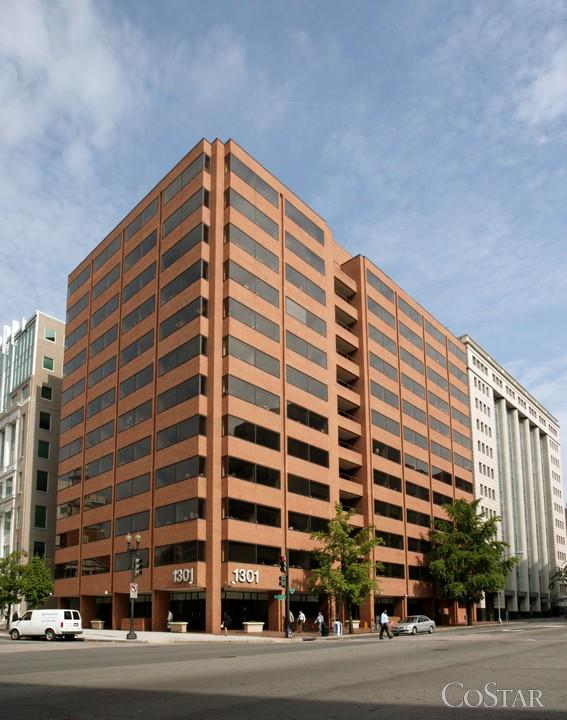 The Department of Justice has renewed its lease at 1301 New York Ave. NW after weighing several other options.