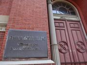 A plaque outside the Franklin School at 935 13th St. NW.