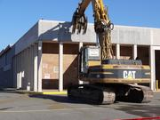 Workers begin the process of demolishing the old Garfinckel's department store at the Springfield Mall on Nov. 26. The mall is scheduled to open in the fall of 2014 as the Springfield Town Center.