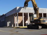 Workers demolish the old Garfinckel's department  store at the Springfield Mall on Nov. 26. The mall is scheduled to open  in the fall of 2014 as the Springfield Town Center.