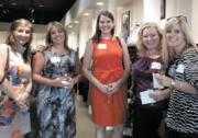 Commercial Real Estate Women D.C. hosted a networking event at Betsy Fisher in the District on Aug. 2 that also treated guests to a fashion show featuring the designer's fall fashions. From left, Susan Denner of Capital Design, Winona Leaman of GPI, and Diana Pavlok, Bridget Hodge and Jenna Opiela, all of Jones Lang LaSalle.