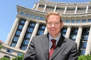 Deloitte & Touche director and former U.S. Rep. Tom Davis.