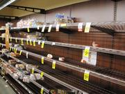 The bread selection in Safeway was not much to look at on Sunday, Oct. 28. Shoppers hit grocery stores throughout the Washington region as Hurricane Sandy approached.
