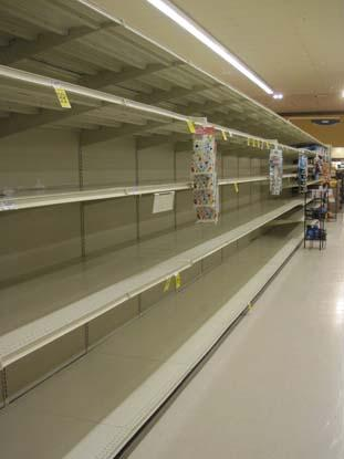Shelves at a Safeway in Arlington were wiped clean of merchandise Sunday night as the Washington region prepared for Hurricane Sandy.
