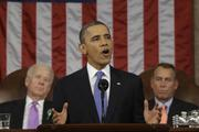 President Barack Obama delivers the State of the Union address as U.S. Vice President Joe Biden, back left, and House Speaker John  Boehner, back right, look on.