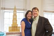 Sabrina Campbell, owner of Occasionally Cake in Old Town Alexandria, with husband Lorne Campbell, debuted a grand opening cake, a replica of the George Washington Masonic Memorial, at the grand-opening celebration of its new shop at 207 King St.
