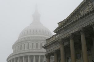 The fiscal cliff deal approved by Congress kept the Triad's representatives working on the New Year's holiday.