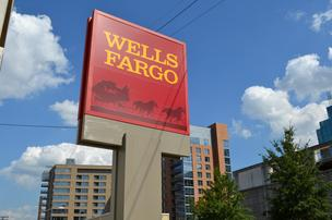 Wells Fargo & Co., the largest U.S. home lender, reported a 24 percent rise in fourth-quarter earnings as the bank boosted lending and squeezed more income out of rising revenue.