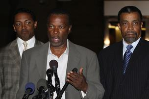 Prince George's County Executive Jack Johnson, center, speaks to the media with his lawyers Brian McDaniel, left, and Billy Martin, outside U.S. District Court on Nov. 12. Johnson and his wife Leslie were arrested by federal law enforcement agents and charged with witness tampering and destruction of records.