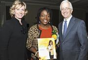 Capital One Bank's Heather Cox and Washington Business Journal's Alex Orfinger presented Fatimah Moody of LinkVisum Consulting Group Inc. with her Women Who Mean Business award.