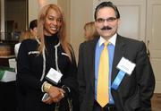 Georgia Griffith, left, of GMG Management Consulting Inc. and Noman Farooqi of Capital One Bank caught up at the Women Who Mean Business annual dinner.