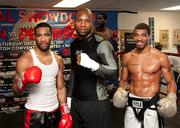 Number-one rated super lightweight contender Lamont Peterson, from left, undefeated heavyweight contender Seth Mitchell and lightweight contender Anthony Peterson posed on Nov. 15 during a media workout in preparation for their Dec. 10 fights.