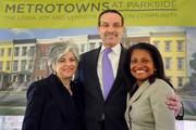 Chickie Grayson, president and CEO of Enterprise Homes Inc.; D.C. Mayor Vincent Gray; and Adrianne Todman, executive director of the D.C. Housing Authority, posed at the groundbreaking ceremony for the new MetroTowns at Parkside in Ward 7 that took place on April 13. MetroTowns is a residential community created by a public-private partnership including the family of Abe and Irene Pollin, Enterprise Homes Inc. and the City of Washington.