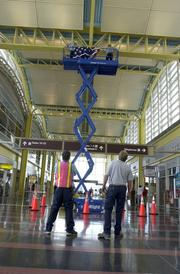 A crew gets ready to hang a flag at Reagan National Airport after the Sept. 11, 2001 attacks.