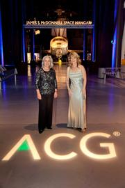 Katie Newland and Annabel Bendz, both of the AGC National Capital Chapter, posed with the soon-to-be-replaced Space Shuttle Enterprise.