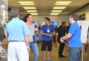 Apple employees chat with customers Friday -- the day the new iPhone 5 was released -- at the company's Reston Town Center store.