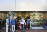 Customers lined up before sunrise at the Apple store in Reston Town Center to take home an iPhone 5.