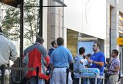 Apple employees offered waiting customers/fans water but little in the way of information regarding the new iPhone 5.