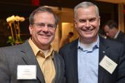 Jonathan Wallace of WWC Capital Group, left, and Christopher Fountain of SecureInfo.