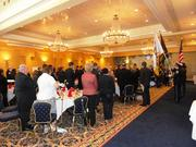 Guests stand for the Presentation of the Colors by the combined Color Guard.