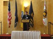 The Valor Awards moderator Steve Chenevey of ABC7 reads a letter of remarks from U.S. Sen. Mark Warner before reading the citations for each award presented.