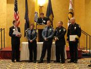 Officer Sara Balch and Officer Sean Gilligan receive the Life-Saving Award, accompanied by Steve Meincke, presented by 2012 Chamber Chairman Doug Brammer and Arlington County Chief of Police M. Douglas Scott.