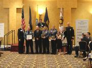 Officer Jason Cox receives the Life-Saving Award and Corporal Steve Gomez and Corporal Mindy Woods receive the Valor with Life-Saving Award, presented by 2012 Chamber Chairman Doug Brammer and Arlington County Chief of Police M. Douglas Scott.