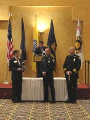 Corporal Kevin Riley receives the Valor with Life-Saving Award, presented by 2012 Chamber Chairman Doug Brammer and Arlington County Chief of Police M. Douglas Scott.