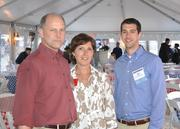 From left, Neil Stablow of Donohoe Construction, ABC Metro Washington Chapter President Debra Schoonmaker and Brian Dickel of Donohoe Construction.