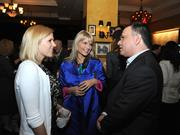 Katherine Kennedy with CEO of Carmine's Jeffrey Bank and a guest.