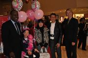 From left, Macy's Vice President and Store Manager Robert Booker, Emma Tran and her parents, and Make-A-Wish Foundation of the Mid-Atlantic Vice President of Philanthropy Mary-Frances Wain.